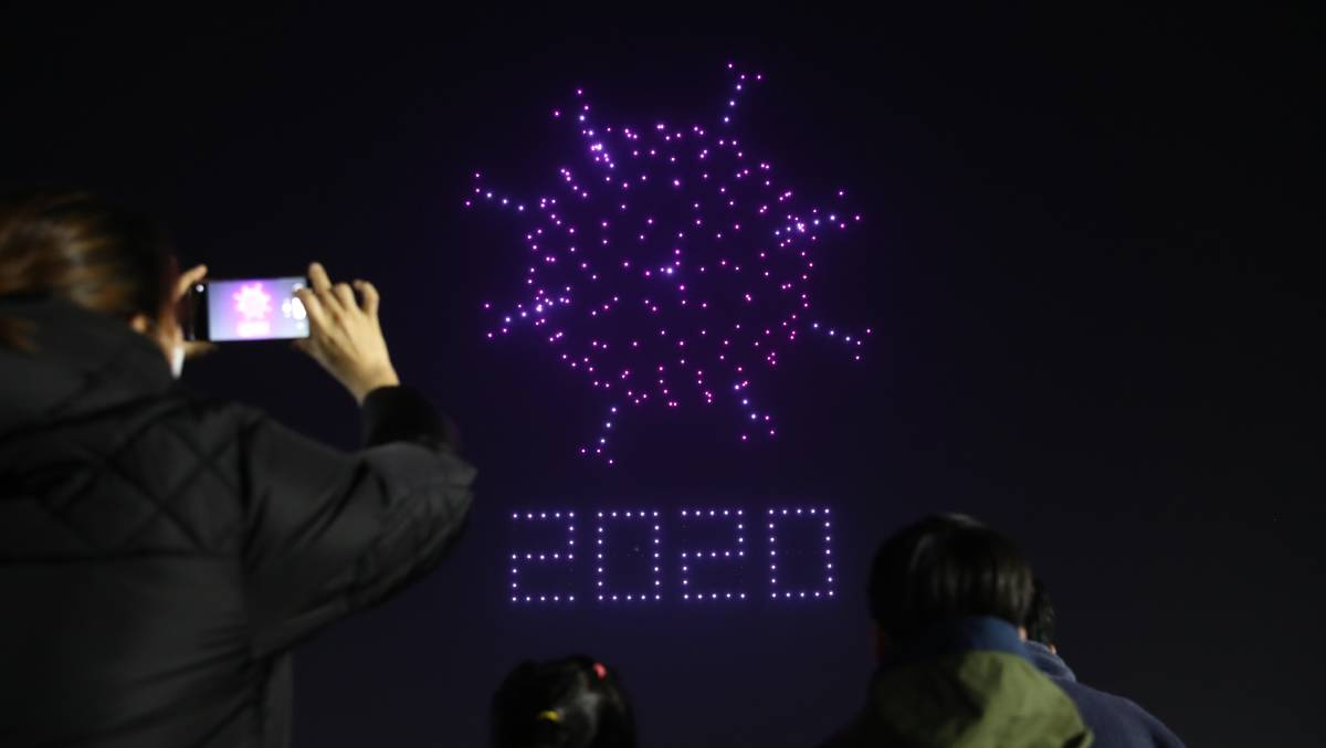 Drones spell out messages about COVID-19 above Seoul Olympic Park. Picture: Getty Images